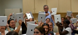 FIU teachers holding up their new iPads.