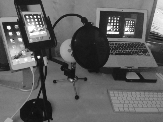 Webinar setup: iPad mini and iPhone mounted on iPevo stand on the left, Mac showing mirrored devices on the right.
