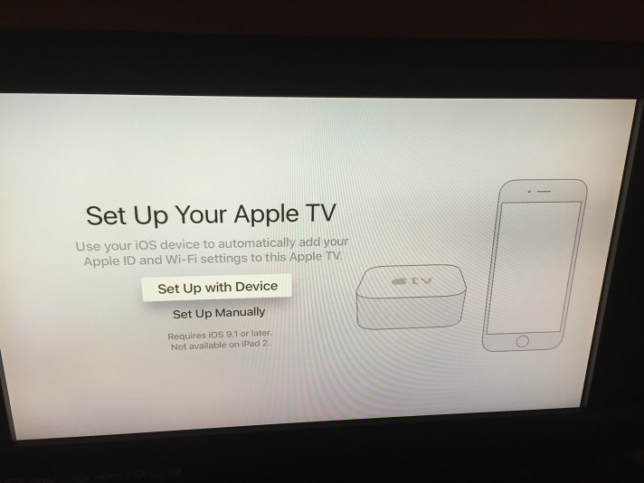 Setup screen for Apple TV showing option to set it up with information from iOS device