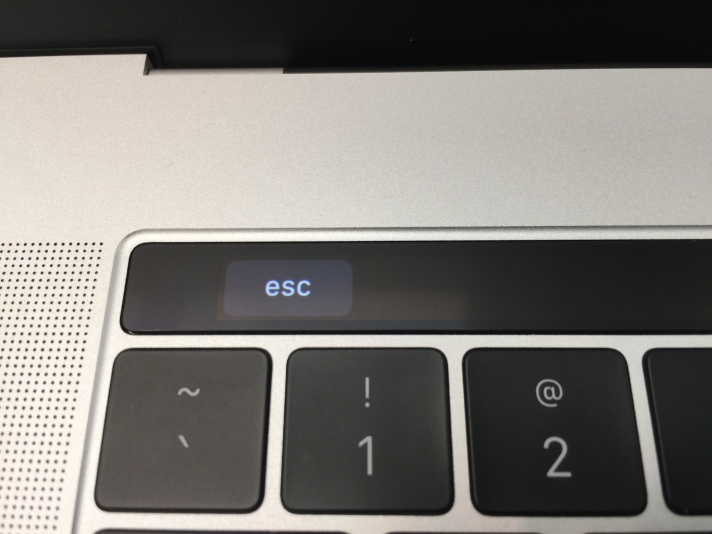 Closeup of left side of the Touch Bar showing a software Escape key
